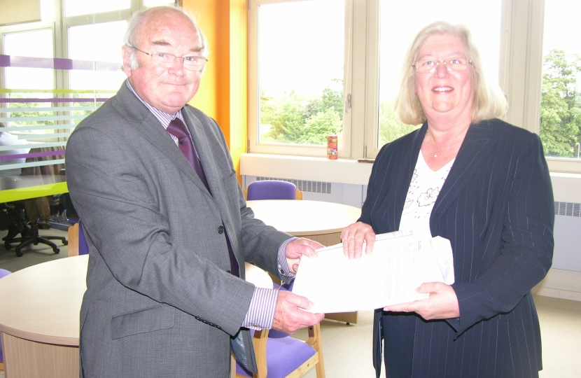 Ivan Ould CC hands Lesley Pendleton the 1,000 name petition